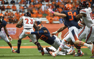 Syracuse takes on Louisville at 12:30 p.m. on Saturday. In 2014 (pictured above), the Cardinals beat the Orange 28-6.