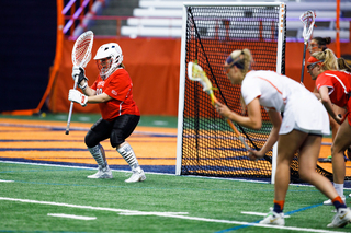 Cornell goalie Renee Poullott prepares to block a free position.